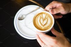 Hands holding a cup by LarisaDeac on @creativemarket