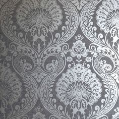 Inspired by the highly popular damask motif, this wallpaper is given a modern twist with its contemporary design style. This stunning wallpaper is finished with a silver shimmering effect that makes it ideal for a feature wall. This textured blown vi Grey Damask Wallpaper, Silver Wallpaper, Star Wallpaper, Embossed Wallpaper, Paper Wallpaper, Vinyl Wallpaper, Textured Wallpaper, Wallpaper Designs, Cheap Wallpaper