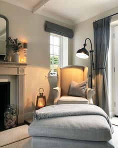 Neutral living room with grey armchair and footstool, Roman blinds and floor lamp. Cosy country farmhouse style home. Cottage Living Rooms, Home Living Room, Interior Design Living Room, Living Room Designs, Living Room Decor, Cottage Shabby Chic, Living Room Remodel, Living Room Inspiration, Cheap Home Decor