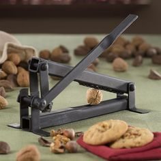 Steel Nutcracker - PERHAPS DESIGN A SIMILAR LEVER , SIMPLER AND PRE-ADJUSTED NOT TO PRESS THE NUT FOR THAN 2 mm SO IT WILL NOT BREAK THE CORE OF THE WALNUT