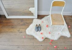 White sheepskin rug and floor mirror in a kids' room in Paris
