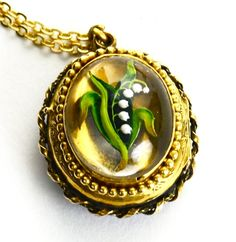 "Victorian Reverse Crystal Locket Featuring a ""Lily of the Valley"""
