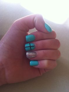 Mint acrylic nails with a cross