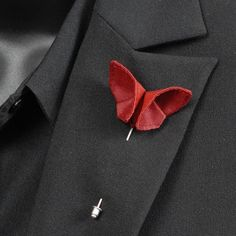 Make a big statement with a stunning silk boutonniere. Each silk origami butterfly boutonniere lapel stick pin is custom made!    I ALSO HAVE DIFFERENT COLORS OF SILK AVAILABLE. There are 100 different colors of silk in stock to choose from!    See them here: http://www.sewsmashing.com/silk-color-swatches/    The origami butterfly is 1 3/4 inch wide and 1 1/8 inch tall. It is meticulously hand sewn to a silver plated metal stick pin. The pin comes with a matching...