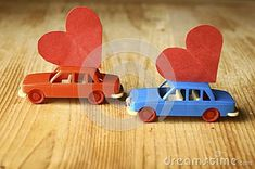 Miniature Plastic Cars Carrying A Heart Stock Photo - Image of childhood, objects: 108122642 Wooden Toys, Carry On, Objects, Childhood, Miniatures, Plastic, Stock Photos, Cars, Red