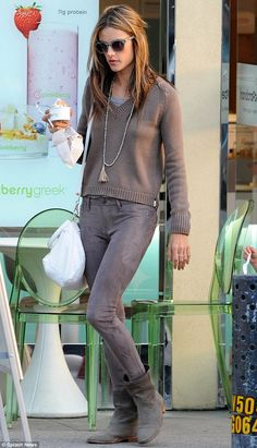 Alessandra Ambrosio.. all brown - tight brown jeans with a knitted V-neck sweater and slouchy brown boots.. California chic..