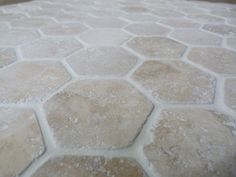 antiqued white travertine hexagon detail #marble #manufactured #armatile
