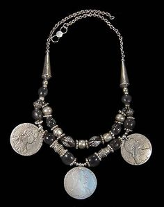 by Amelia Herrán | Antique Islamic silver prayer bead (ca. 1900) combined with old Maria Theresa, caged beads from Yemen (ca. early 1900s)  coins and black coral inlaid with silver from Yemen/Turkey from the late 1800s to early 1900s. | Price on request