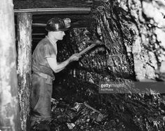 1939: A miner at work with a pick axe at the coal face in the Ashington Coal Companies Colliery at Newcastle upon Tyne.