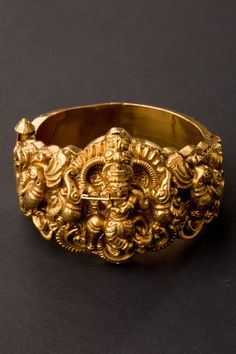 Tamil Nadu, South India Gold bracelet depicting Krishna Venugopal, with peacocks on either side. India Jewelry, Temple Jewellery, Tribal Jewelry, Gold Jewelry, Wedding Jewelry, Body Jewellery, Diamond Jewellery, Wedding Accessories, Wedding Hair