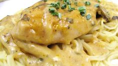 Bake chicken breasts in a delectably rich sauce made of butter, dry Italian salad dressing mix, wine, golden mushroom soup and cream cheese with chives. Serve over angel hair pasta for a dish that is fit for your most elegant dinner parties.