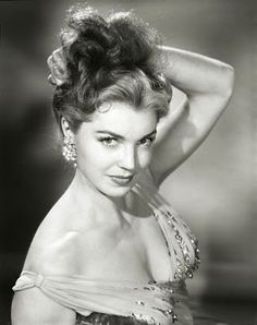 Esther Williams: Competitive Swim Champion & Actress; scheduled to compete in 1940 Olympics before World War II cancelled them. http://goldenhollywoodera.com/estherwilliams.php