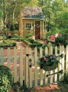 Too cute for words.....Love the fence and all the details. Makes it look cozy and formal all at the same time.
