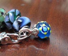 Have you ever seen a unique glass Trollbeads drop? This one is hanging on my own bracelet but it actually belongs in my Trollbeads museum...which by the way is the only one of its kind. To see it come to TROLLBEADS FEST!! :-)