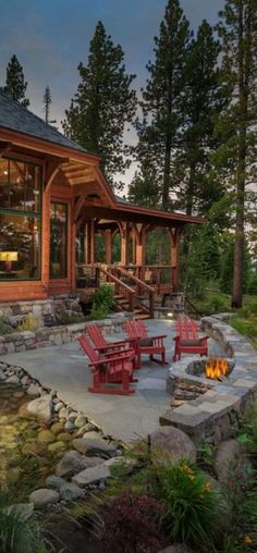 Slate patio with fire pit & red chairs