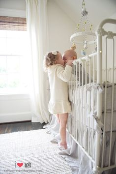 Hee hee- cute! Have your big sibling go in and say good morning to your baby for a sweet shot (and a little bit of coralling).