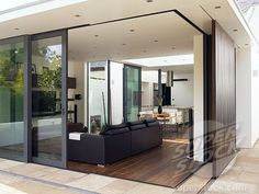 Sliding glass doors open the corner of this house.