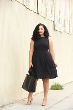 Tanesha Awasthi, also known as Girl With Curves, wearing a plus size gingham…