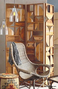 Recycled teak, selected for its intriguing grain and hue, is sanded to a velvety-smooth finish and shaped to form this modern screen. Two - and three-dimensional shapes create a playful pattern, with open spaces for an intriguing peekaboo effect. Finished with satin nickel hardware.