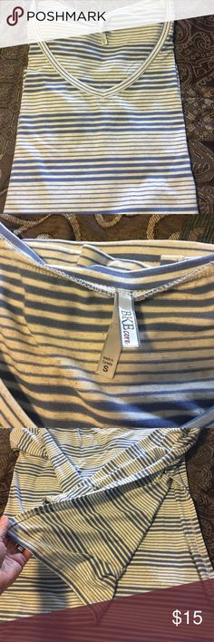 Buckle V neck T Size S A new without tag BKE Buckle tee Size S. This is a Vneck with long sleeve and side slits. I didn't realize it had the side slits when I bought it so just won't wear. It's a light blue stripe with cream/gray color. Super comfy Buckle Tops Tees - Long Sleeve