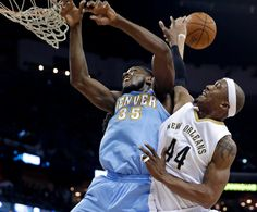 Description of . Denver Nuggets forward Kenneth Faried (35) and New Orleans Pelicans forward Dante Cunningham (44) vie for the ball under the basket during the first half of an NBA basketball game in New Orleans, Wednesday, Jan. 28, 2015. (AP Photo/Gerald Herbert)