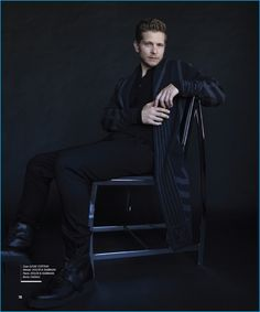 Matt Czuchry dons a Louis Vuitton coat with a henley and pants by Dolce & Gabbana. Czuchry also sports Canali leather boots.