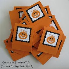 Matchbook Pumpkin Treats. I scored the paper while it was still 8 1/2 x 11 and then cut it. If you don't have a Scor-Pal you have to get one. Cut the cardstock 8 1/2 x 3. Sore at 5 inches and 1 inch. Decorate the front, attach the candy with a staple and close.