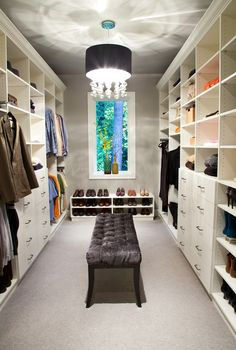 Place a bench in the center of your closet when you don't have room for an island.