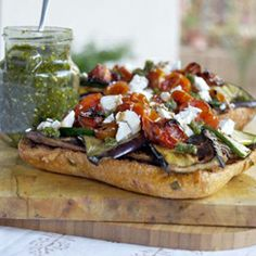 Sun-dried tomato bread smothered in garlic pesto and topped with #chargrilled #veggies.