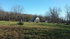 Location, Location, Location- this 136 acres m/l mostly wooded has a 24x36 pole barn with electric, 2 -10'' sliding doors, with cement floors. Older 2 bedroom, one bath home with well and electric. Live spring and misc. outbuildings. Located off of Blacktop road frontage- 16 miles down Y Highway from Mtn. View. In Willow Springs School District in Willow Springs MO