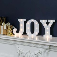 Spread Joy around your home with these battery light up circus letters, with warm white LEDs. #christmasdecor #christmas #lightupletters #cosy #homedecor #interiordesign #feelgood