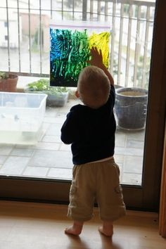 Love this! Just put finger pan in a plastic ziploc bag, tape to the window, and enjoy hours of painting with NO MESS!
