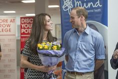 Kate pulls a face at her husband as she clutches a bouquet of flowers at the event hosted ...