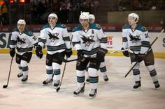 The Worcester Sharks skate back to the bench after scoring a goal (March 8, 2014).