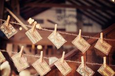 A fun and decorative way to set up seating cards, like a clothes line, very cute.