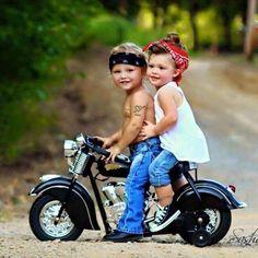 Little girl and boy on mini motorcycle adorable beautiful