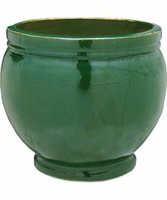 Green plant pot! Perfect to have on each side of the front door with some little flowers in it!