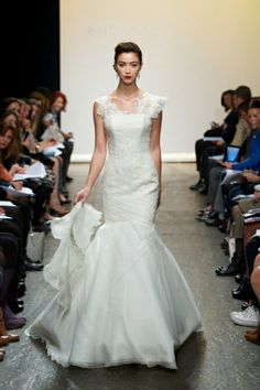 Fit-to-flare tulle gown with Alençon lace appliqué throughout bodice and asymmetrical pleaded Organza strap.