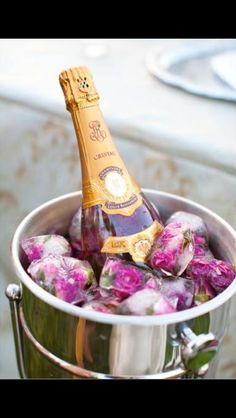Champagne chilling on a bed of rose ice-cubes! Love it!