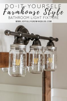 Goodbye builder grade, hello Farmhouse! Checkout this easy DIY tutorial on how to upgrade your light fixture on a budget! #DIYbathroom #BathroomMakeover #FarmhouseBathroom