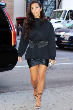 Kim Kardashian West Rocks a Sweatshirt and Leather Corset to Take North West to the Movies from InStyle.com