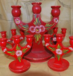 Flowers like these appear on english canalware too Vintage Swedish Folk Art Candelabra - I think these are a prerequisite to a Swedish Christmas. I've got mine!
