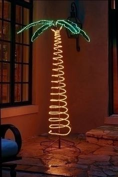 7' Deluxe Tropical Lighted Holographic Rope Light Outdoor Palm Tree Decoration by Roman. $169.99. 7 Foot Holographic Lighted Palm TreeFrom the Tropical CollectionItem #161722Can't make it to the tropics this year? Who cares when you have all the fun and fantasy right in your own back yard (or basement)? Our holographic palm tree is a party favorite, covered with shimmering lights from the trunk to leafy green frondsFeatures:4-piece easy assembly, set up is a snapWire...