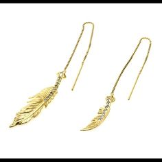 Feather Earrings Gold large & small feather matte w/Crystal Silver Shade Swarovski crystals, gold plated threader box chain w/ring, plastic ear guards, black colette malouf earring card, anti-tarnishing strip, brass usa tag High end accessories company based in New York. Once the designer's items sell out they are no longer made. Colette Malouf Jewelry Earrings