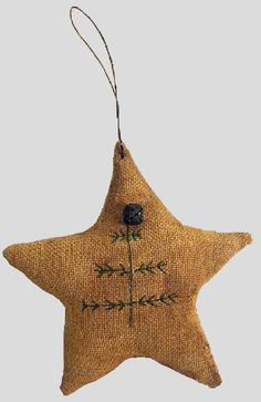 A folksy star with embroidery and a little jingle bell.