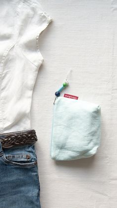 Beautiful light blue linen zipper pouch with wooden bead charm. It is perfect to keep your makeup, jewelry or just to use it as a purse! Handmade from preloved fabric. Absolutely eco-friendly, vegan slow fashion item for you or for gifting. Limited numbers are available, click now to see more!