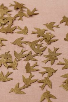 REVEL: Fly Away Confetti…puchase info in link…pretty/elegant on top of burlap cloth