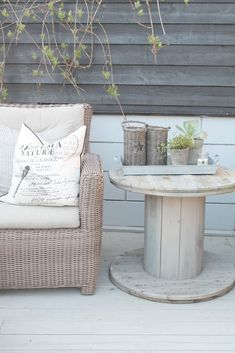 .use old wire spools to create a quaint little side table..
