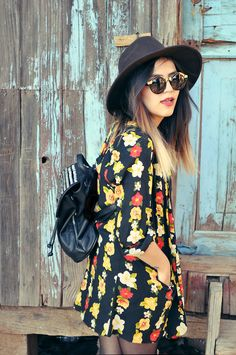 Grunge style - Floral dress, sun hat, round sunglasses and leather backback. Very cute for spring
