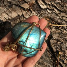 New labradorite blue flash heart pendant that I wrapped in solid Brass wire.